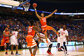 Malachi Richardson of the Syracuse Orange drives to the basket and is fouled by Dyshawn Pierre of the Dayton Flyers in the second half during the...