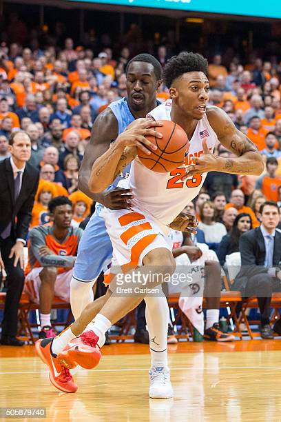 Malachi Richardson of the Syracuse Orange drives to the basket as Theo Pinson of the North Carolina Tar Heels grabs at him on January 9 2016 at The...