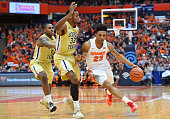 Malachi Richardson of the Syracuse Orange drives to the basket past James White and Marcus GeorgesHunt of the Georgia Tech Yellow Jackets during the...