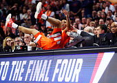 Malachi Richardson of the Syracuse Orange falls off of the court in the second half against the Virginia Cavaliers during the 2016 NCAA Men's...