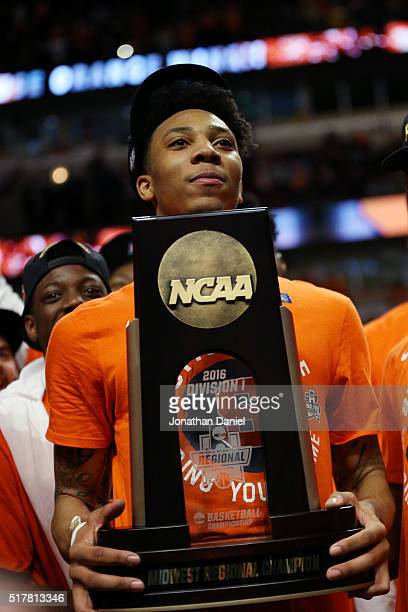 Malachi Richardson of the Syracuse Orange holds the trophy as he celebrates their 68 to 62 win over the Virginia Cavaliers during the 2016 NCAA Men's...