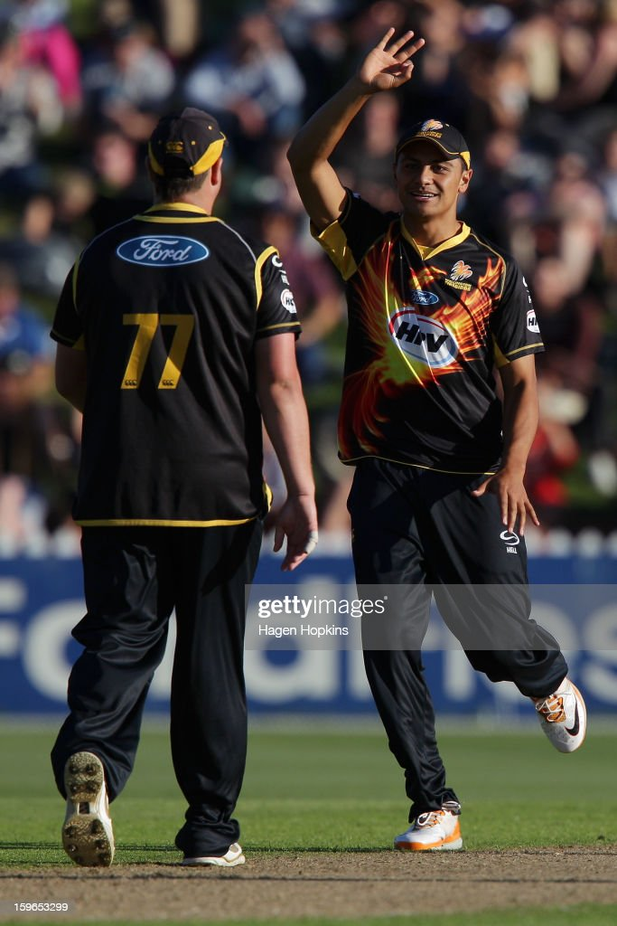 Malaesaili Tugaga of Wellington congratulates Jesse Ryder on his over during the HRV Cup Twenty20 Preliminary Final between the Wellington Firebirds and the Auckland Aces at Basin Reserve on January 18, 2013 in Wellington, New Zealand.