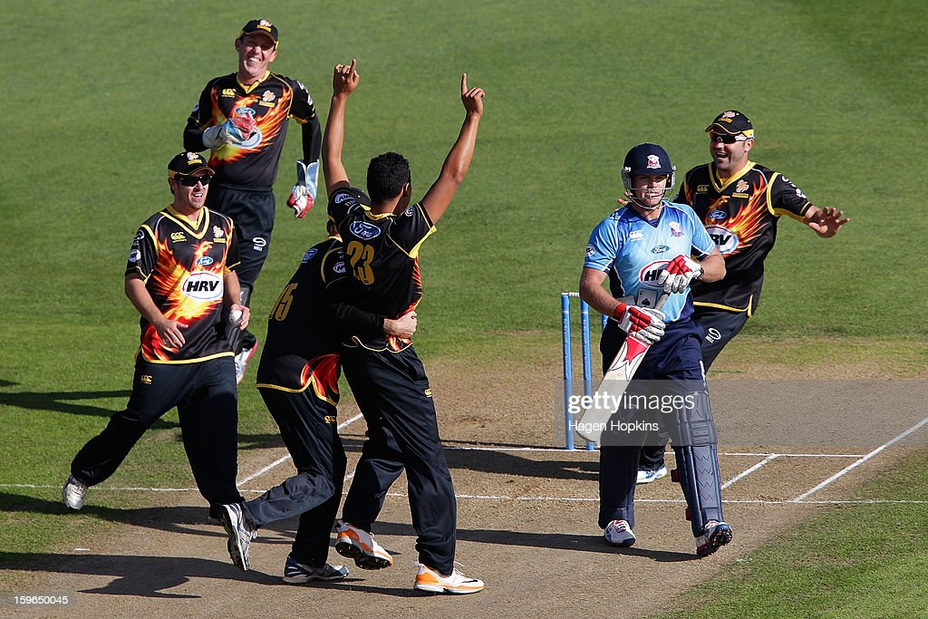 Malaesaili Tugaga of Wellington is congratulated after taking the wicket of <a gi-track='captionPersonalityLinkClicked' href=/galleries/search?phrase=Lou+Vincent&family=editorial&specificpeople=224005 ng-click='$event.stopPropagation()'>Lou Vincent</a> of Auckland during the HRV Cup Twenty20 Preliminary Final between the Wellington Firebirds and the Auckland Aces at Basin Reserve on January 18, 2013 in Wellington, New Zealand.