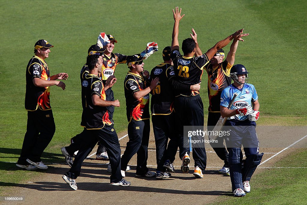 Malaesaili Tugaga of Wellington (23) is congratulated after taking the wicket of Lou Vincent of Auckland during the HRV Cup Twenty20 Preliminary Final between the Wellington Firebirds and the Auckland Aces at Basin Reserve on January 18, 2013 in Wellington, New Zealand.