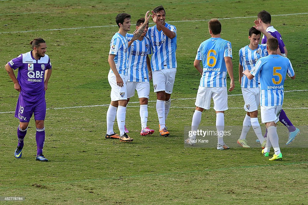 Malaga celebrate the opening goal during the International Club friendly match between Malaga CF and Perth Glory at nib Stadium on July 27 2014 in...