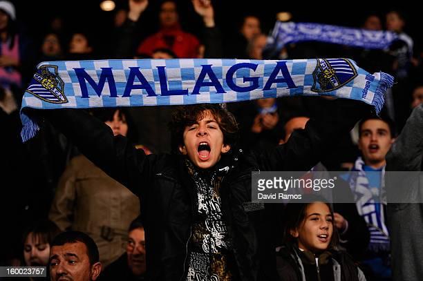 Malaga CF fan cheers his team during the Copa del Rey Quarter Final 2nd leg match between Malaga CF and FC Barcelona at La Rosaleda Stadium on...