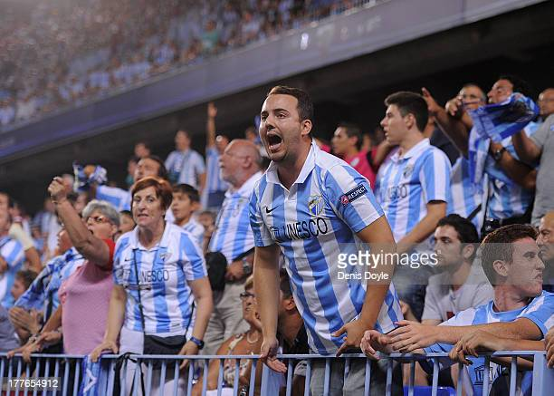 Malaga CF fans react during the La Liga match between Malaga CF and FC Barcelona at La Rosaleda Stadium on August 25 2013 in Malaga Spain