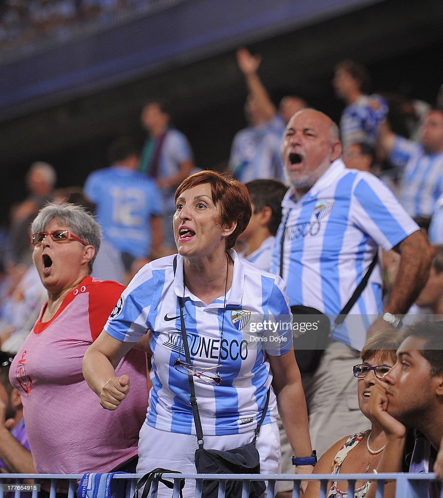 Malaga CF fans react during the La Liga match between Malaga CF and FC Barcelona at La Rosaleda Stadium on August 25, 2013 in Malaga, Spain.