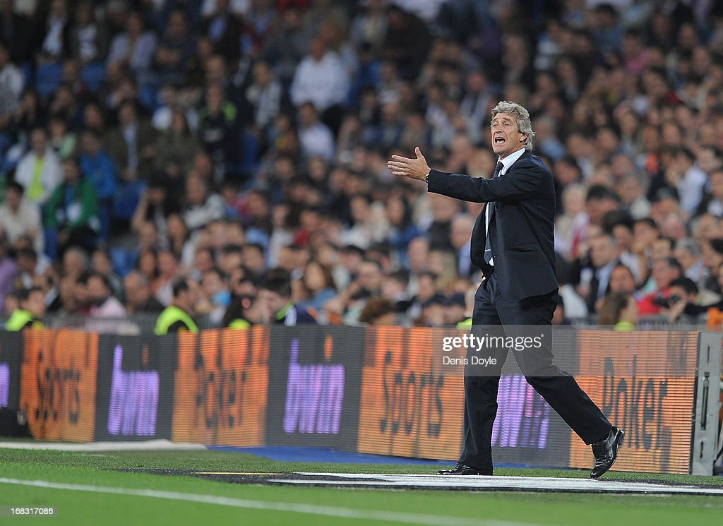 Malaga CF head coach <a gi-track='captionPersonalityLinkClicked' href=/galleries/search?phrase=Manuel+Pellegrini&family=editorial&specificpeople=673553 ng-click='$event.stopPropagation()'>Manuel Pellegrini</a> reacts during the La Liga match between Real Madrid CF and Malaga CF at estadio Santiago Bernabeu on May 8, 2013 in Madrid, Spain.