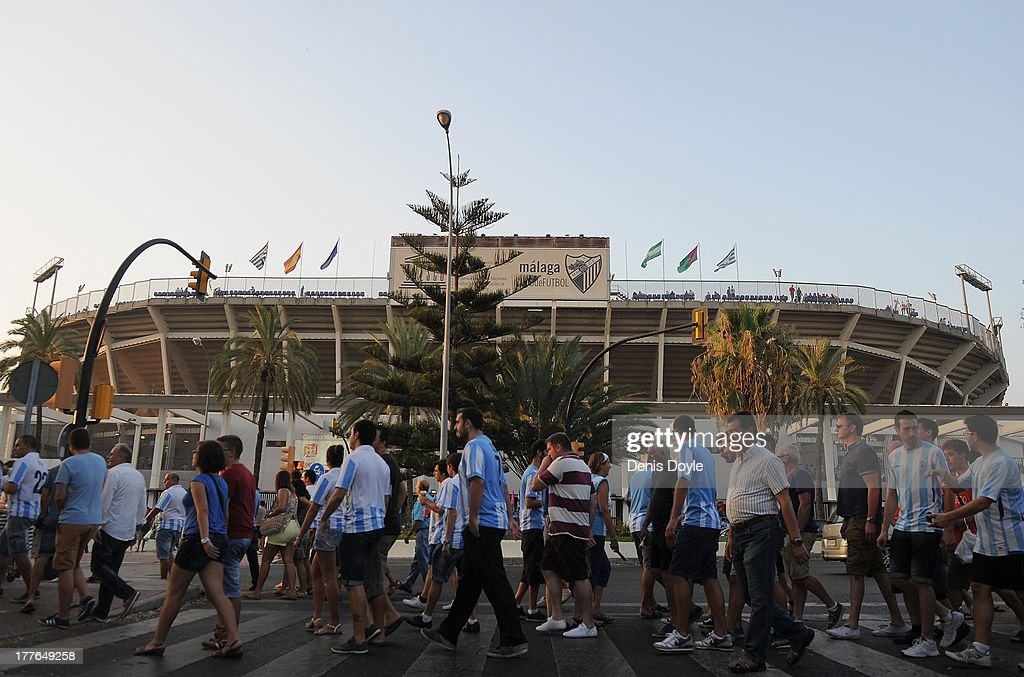 Malaga CF supporters make their way to La Rosaleda Stadium for the La Liga match between Malaga CF and FC Barcelona at La Rosaleda Stadium on August 25, 2013 in Malaga, Spain.