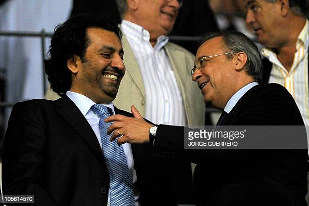 Malaga CF's chairman Sheikh Abdallah Ben Nasser AlThani chats with Real Madrid's president Florentino Perez during their Spanish league football...