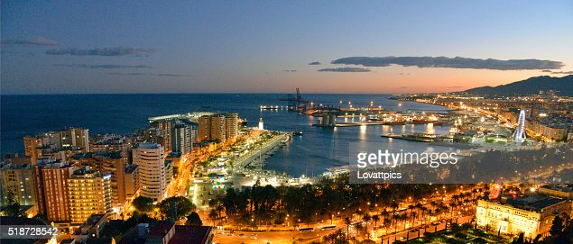 Malaga city and port area at night.