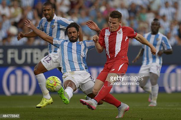 Malaga's Argentinian defender Marcos Alberto Angeleri vies with Sevilla's French forward Kevin Gameiro during the Spanish league football match...