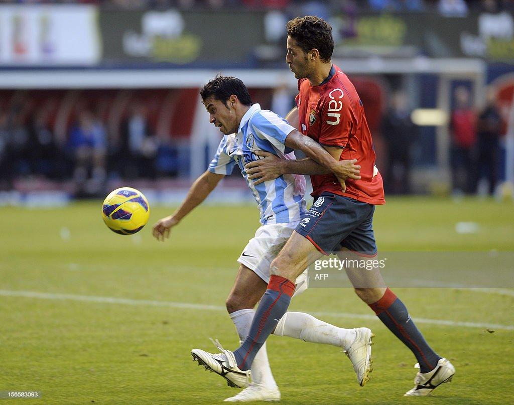 Malaga's Argentinian forward Javier Saviola (L) vies with Osasuna's defender Damia Abella (R) during the Spanish league football match CA Osasuna vs Malaga CF on November 17, 2012 at the Reyno de Navarra stadium in Pamplona.