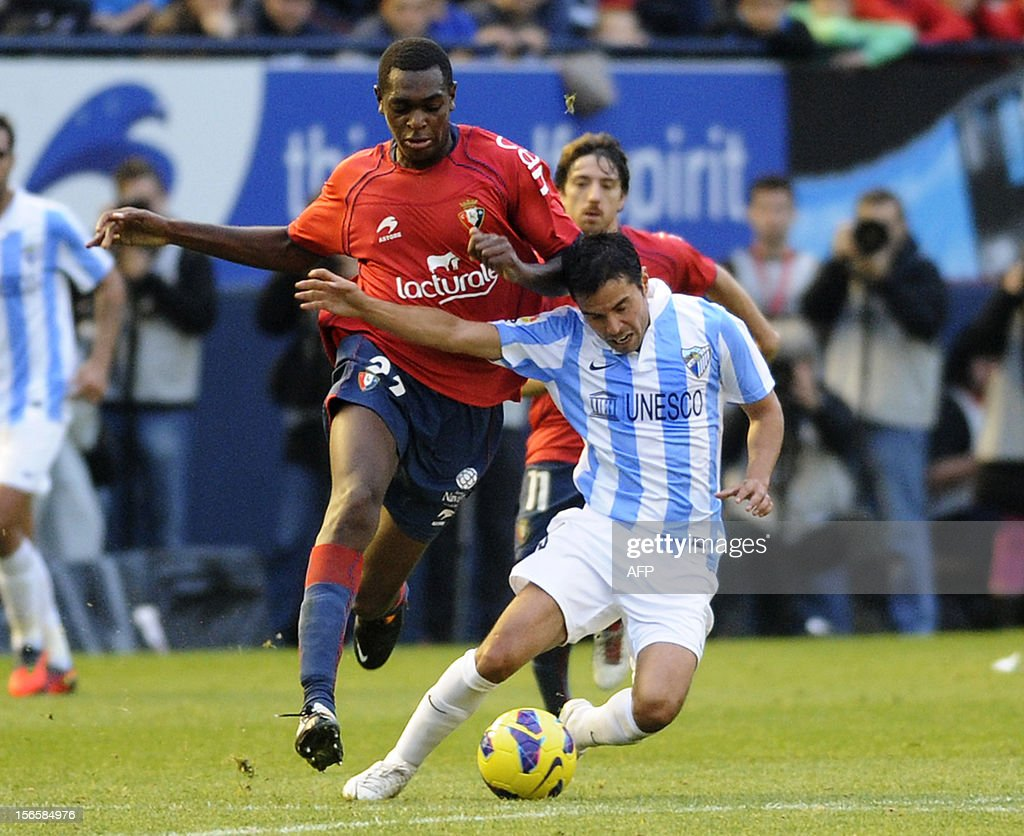 Malaga's Argentinian forward Javier Saviola (R) vies with Osasuna's French midfielder Raoul Loe (L) during the Spanish league football match CA Osasuna vs Malaga CF on November 17, 2012 at the Reyno de Navarra stadium in Pamplona.
