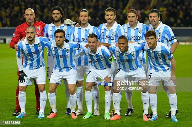 Malaga's Argentinian goalkeeper Willy Caballero defender Sergio Sanchez Argentinian defender Martin Demichelis midfielder Ignacio Camacho Malaga's...