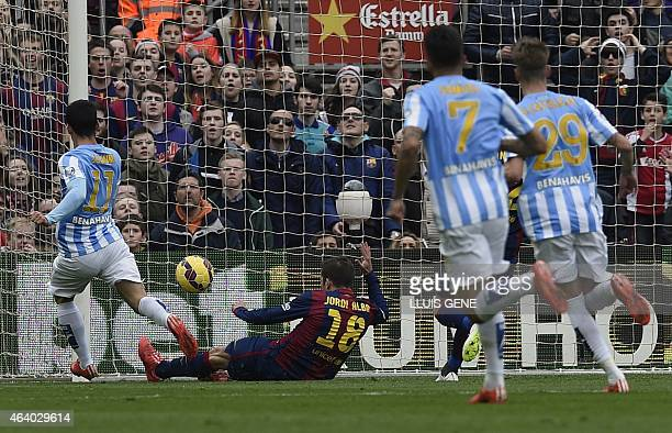 Malaga's Argentinian midfielder Pablo Javier Perez scores a goal during the Spanish league football match FC Barcelona vs Malaga CF at the Camp Nou...