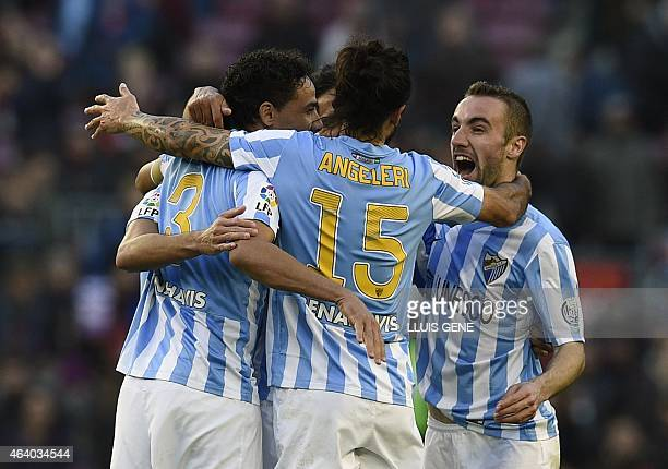 Malaga's Brazilian defender Weligton Malaga's Argentinian defender Marcos Alberto Angeleri and Malaga's midfielder Sergi Darder celebrate after the...