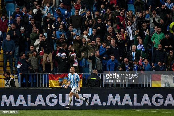 Malaga's Brazilian forward Charles Dias de Oliveira celebrates after scoring during the Spanish league football match Malaga CF vs Club Atletico de...