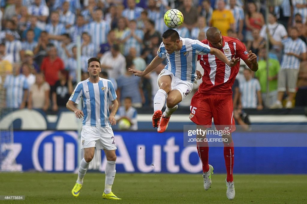 Malaga's Brazilian forward Charles Dias de Oliveira vies with Sevilla's French midfielder Steven N'Kemboanza Mike N'Zonzi during the Spanish league...