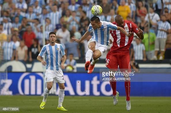 Malaga's Brazilian forward Charles Dias de Oliveira vies with Sevilla's French midfielder Steven N'Kemboanza Mike N'Zonzi during the Spanish league...
