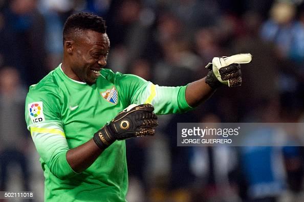 Malaga's Cameroonian goalkeeper Carlos Kameni celebrates after winning 10 the Spanish league football match Malaga CF vs Club Atletico de Madrid at...