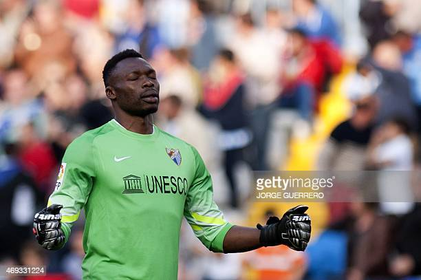 Malaga's Cameroonian goalkeeper Carlos Kameni celebrates the goal of his forward Samuel Garcia Sanchez during the Spanish league football match...
