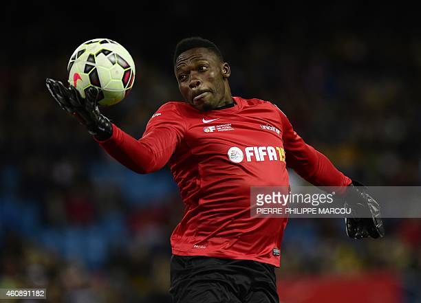 Malaga's Cameroonian goalkeeper Idriss Kameni stops the ball during the second match of the 'Champions for Life' charity games organized by the...