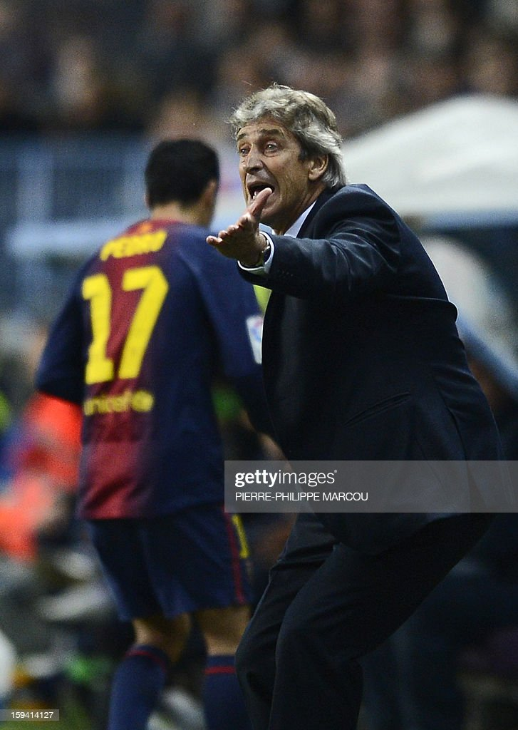 Malaga's Chilean coach Manuel Pellegrini gestures during the Spanish league football match Malaga vs Barcelona on January 13, 2013 at la Rosaleda stadium in Madrid.