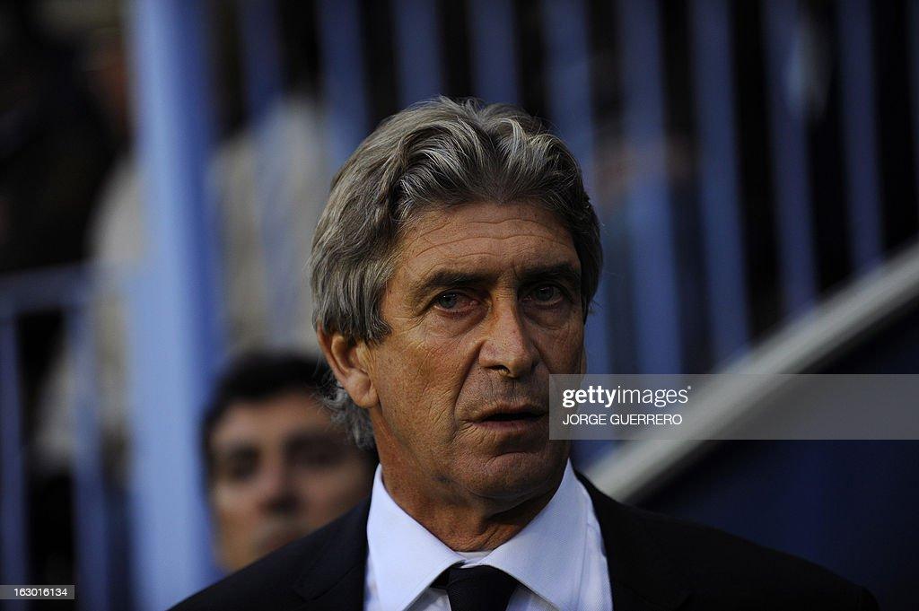 Malaga's Chilean coach Manuel Pellegrini reacts before the Spanish league football match Malaga CF vs Atletico de Madrid on March 3, 2013 at Rosaleda stadium in Malaga.
