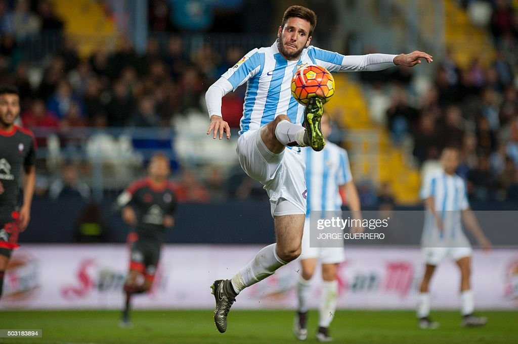 Malaga's Croatian forward Duje Cop controls the ball during the Spanish league football match Malaga CF vs RC Celta de Vigo at La Rosaleda stadium in...