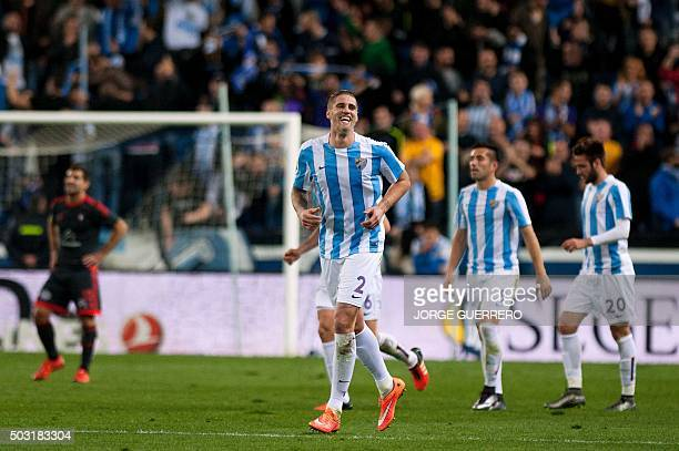 Malaga's defender Raul Albentosa celebrates after scoring during the Spanish league football match Malaga CF vs RC Celta de Vigo at La Rosaleda...