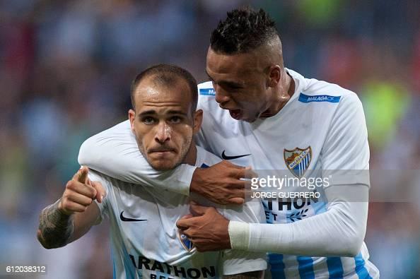 Malaga's forward Sandro Ramirez celebrates with Malagas Morocco forward Youssef EnNesyri after scoring during the Spanish league football match...