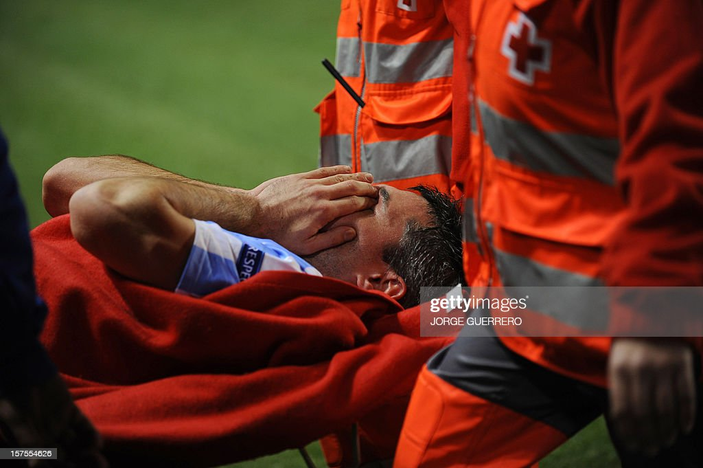 Malaga's French midfielder Jeremy Toulalan lies on a stretcher after being injured during the UEFA Champions League Group C football match Malaga CF vs RSC Anderlecht at La Rosaleda stadium in Malaga on December 4, 2012.