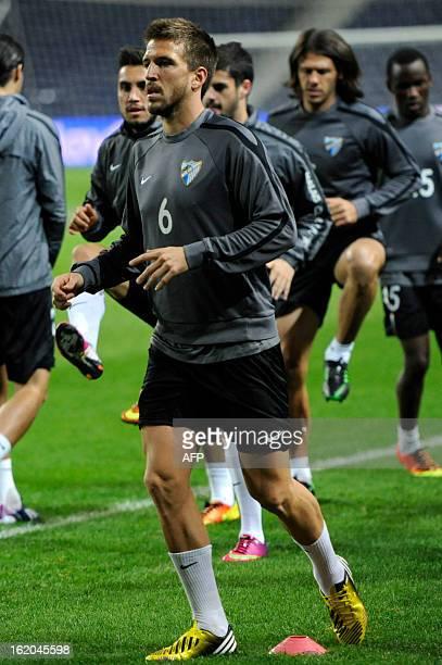 Malaga's midfielder Ignacio Camacho attends a training session at Dragao Stadium in Porto on February 18 on the eve of the UEFA Champions League...