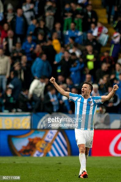 Malaga's midfielder Ignacio Camacho celebrates after winning 10 the Spanish league football match Malaga CF vs Club Atletico de Madrid at La Rosaleda...
