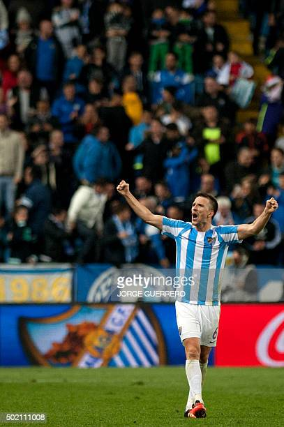 Malaga's midfielder Ignacio Camacho celebrates after winning 10 the Spanish league football match Malaga CF vs Club Atletico de Madrid at La Rosaleda...