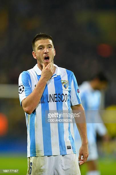 Malaga's midfielder Ignacio Camacho reacts after the UEFA Champions League quarterfinal secondleg football match Borussia Dortmund vs Malaga CF in...