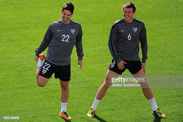 Malaga's midfielder Isco and midfielder Ignacio Camacho attend a training session on April 2 2013 at Rosaleda stadium in Malaga on the eve of the...