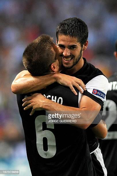 Malaga's midfielder Isco celebrates with Malaga's midfielder Ignacio Camacho after scoring during their UEFA Champions league football match Malaga...