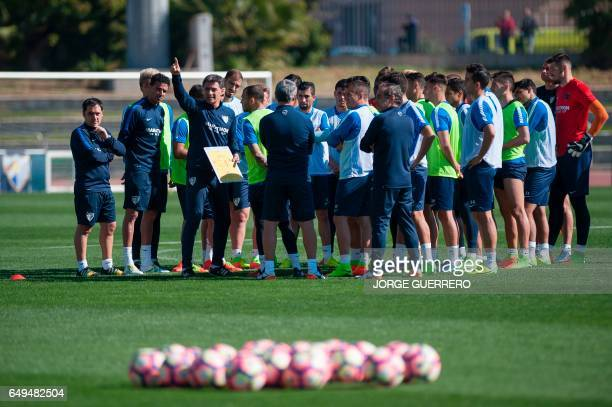 Malaga's new coach Michel gives instructions to his players during a training session at the Ciudad de Malaga stadium in Malaga on March 8 2017 / AFP...