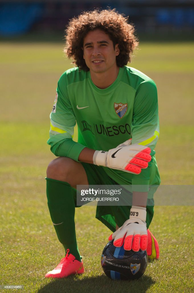 Malaga's new Mexican goalkeeper Guillermo Ochoa poses during his official presentation at the Rosaleda stadium in Malaga on August 1 2014 AFP PHOTO/...