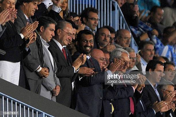 Malaga's Qatari president Sheikh Abdullah Al Thani smiles at the end of the UEFA Champions league football match Malaga CF vs AC Milan on October 24...