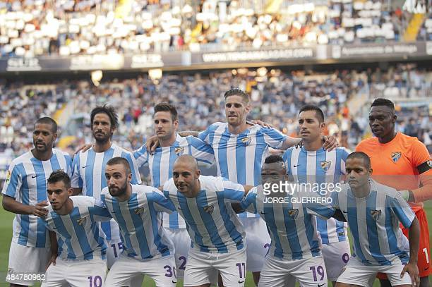Malaga's team pose before the Spanish league football match Malaga CF vs Sevilla FC at La Rosaleda stadium in Malaga on August 21 2015 AFP PHOTO /...