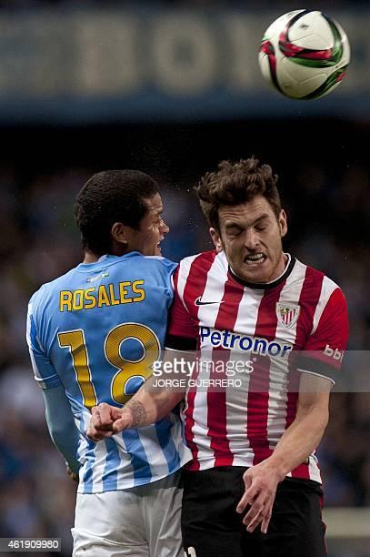 Malaga's Venezuelan defender Roberto Jose Rosales vies with Athletic Bilbao's forward Ibai Gomez during the Spanish Copa del Rey quarter final...
