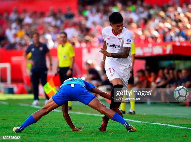 Malaga's Venezuelan defender Roberto Rosales vies with Sevilla's Argentinian midfielder Joaquin Correa during the Spanish league football match...