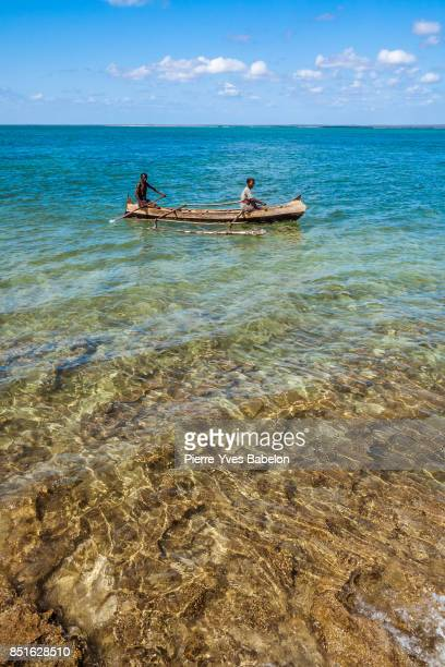 Malagasy couple in their outrigger canoe