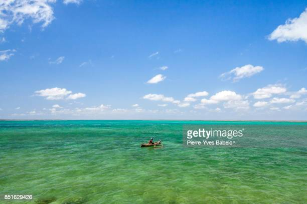 Malagasy fisherman in his outrigger canoe