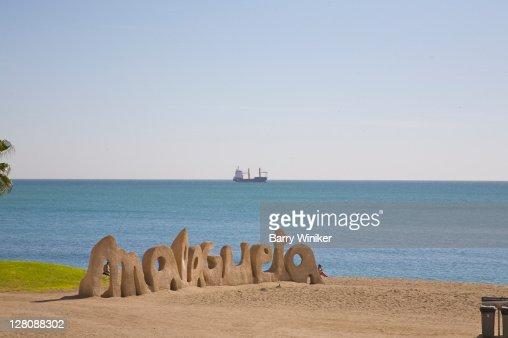 Malagueta sign on beach of Malaga with boat on the Mediterranean Sea, Costa del Sol, Andalucia, Spain