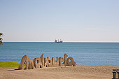 Malagueta sign on beach of Malaga with boat on the Mediterranean Sea, Costa del Sol, Andalucia, Spain